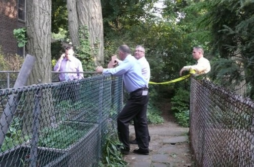 Investigators in Sunnyside Gardens Monday