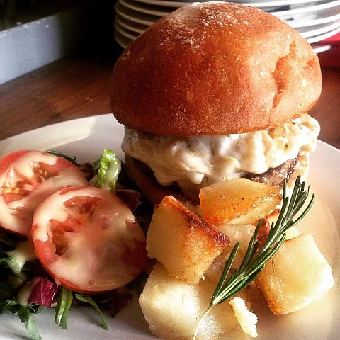 Soleluna Burger with Mozzarella Cheese, Mustard, Carmelized Red Onions and Tomatoes